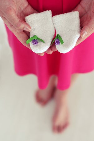 baby shoes newborn in the hands of mothers, baby shower holiday