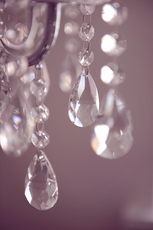 Chrystal chandelier close-up. wedding details. Glamour background. Soft focus, watercolor toning.