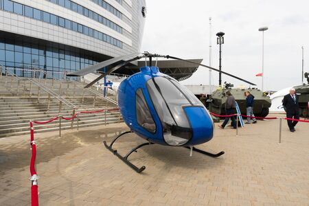 BELARUS, MINSK, 17 May 2019: 9th International Exhibition of Armament and Military Equipment Milex - 2019. small helicopter 報道画像
