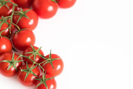 Branch of a fresh red tomato cherry, isolated on a white background