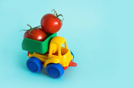 tomatoes natural vitamins are in the back of truck in a childrens toy car food delivery truck logistics