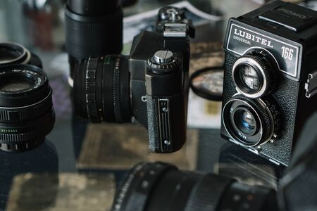 Belarus, Soligorsk, July 1, 2019: many old variety of Soviet film analog retro cameras and lenses close-up in photo studio or museum collection