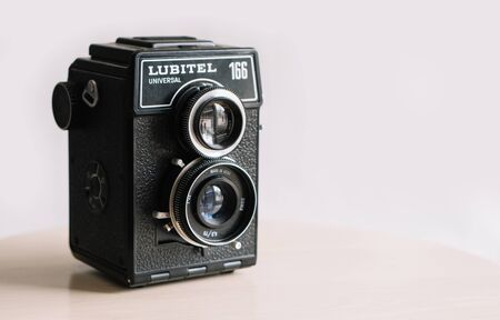 Belarus, Soligorsk, July 1, 2019: The old retro widescreen film camera Lubitel Universal 166 on white background