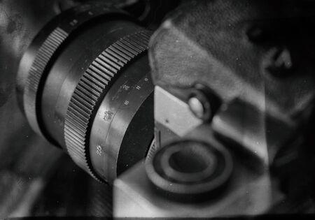 The old retro widescreen film camera on white background stylized film imitation