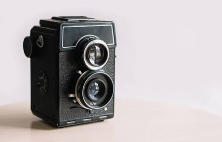 The old retro widescreen film camera on white background