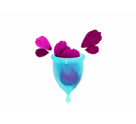 woman personal hygiene item for a period, a blue menstrual cup filled with flower petals, like a metaphor of a drop of blood splashing overflowed on a white background