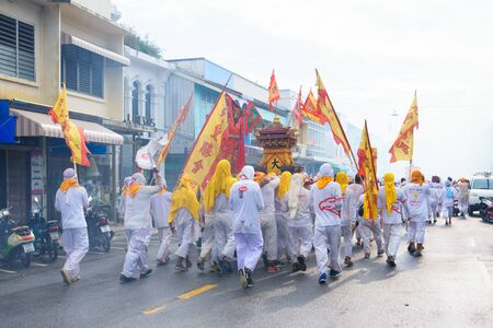 Thailand, Phuket, October 7, 2019: annual Vegetarian Festival (nine imperial gods), a street procession along the streets of Phuket town near the temple people in white robes with ritual religious accessories