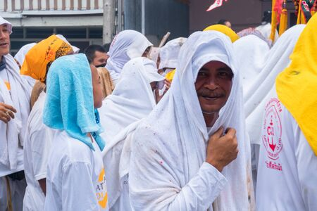 Thailand, Phuket, October 5, 2019: annual Vegetarian Festival (nine imperial gods), a street procession along the streets of Phuket town near the temple people in white robes with ritual religious accessories