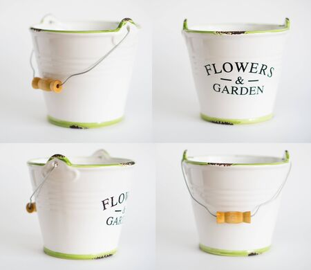 white garden bucket with a green border and a wooden handle on a white fna isolated 写真素材