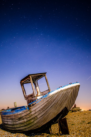 Night sky above a wrecked boat