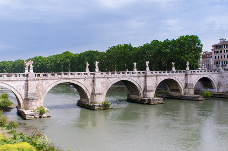 St. Angelo Bridge, built by the Roman Emporer Hadrian, is a pedestrian bridge. Spanning the River Tiber., it was built in 134 A.D., with travertine marble fascias