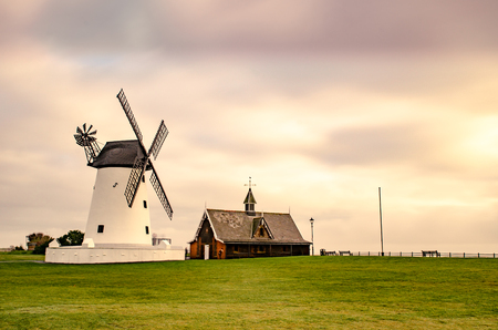A long exposure of Lytham Windmill with soft pastel textures and colours in the sky above