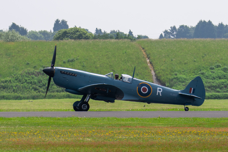 TELFORD, UK, JUNE 10, 2018 - A photograph documenting a Supermarine Spitfire taxiing on the airfield at RAF Cosford
