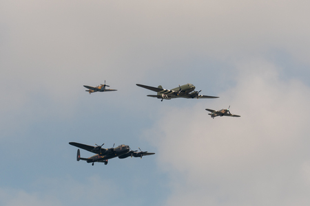 TELFORD, UK, JUNE 10, 2018 - A photograph documenting the Battle of Britain Memorial Flight performing their Trenchard formation display to celebrate the centenary of the RAF