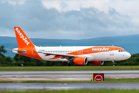MANCHESTER UK, 30 MAY 2019: Easyjet Airbus A320 flight U21912 from Palma de Mallorca lands on runway 23R at Manchaester Airport.