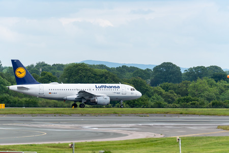 MANCHESTER UK, 30 MAY 2019: Lufthansa Airbus A319 flight LH939 to Frankfurt taxies onto Runway 28L at Manchester Airport for take off.