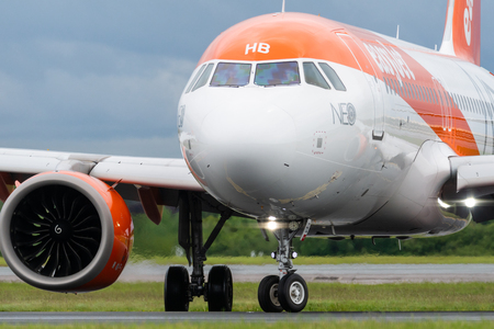 MANCHESTER UK, 30 MAY 2019: Easyjet Airbus A320 flight U21998 from Luqa turns off runway 23R at Manchaester Airport after landing.