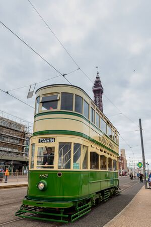 BLACKPOOL, UK, JUNE 30 2019: A Heritage Tram travels along the tramway with Blackpool Tower in the background Redactioneel