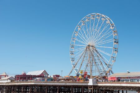 BLACKPOOL, UK, JUNE 30 2019: A photograph documenting the ferris wheel on the Central Pier at Blackpool.