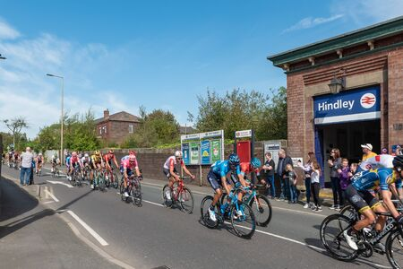 WIGAN, UK 14 SEPTEMBER 2019: A photograph documenting the riders of the Tour of Britain race as it passes through Hindley, in Greater Manchester. Editoriali
