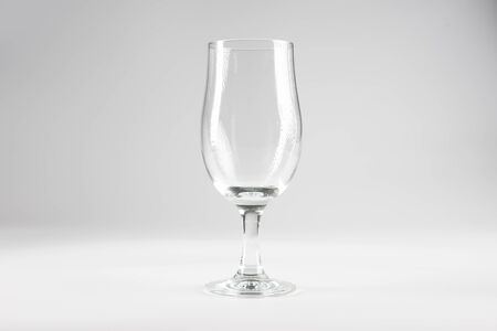 An empty beer glass set against a white background