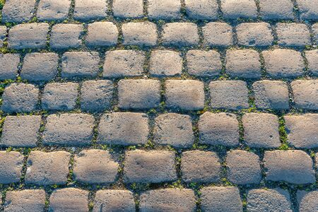Cobblestones seen on Railway Street, Wigan, during an early morning on a sunny day.