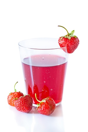 Berry compote with fresh strawberries in glass isolated