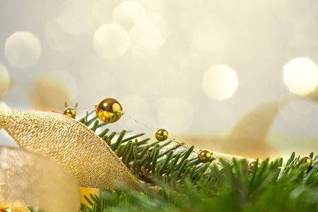 Christmas seasonal background with spruce and golden beads Stock Photo