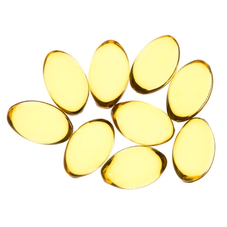 Yellow pills isolated background