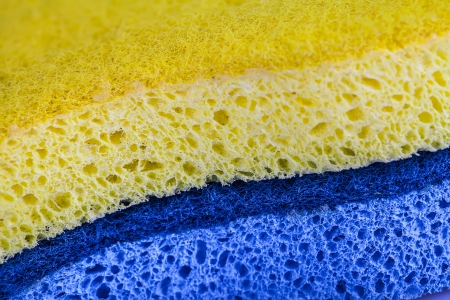 porous: Yellow and blue sponges Stock Photo