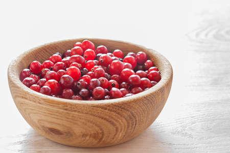 Cranberries in wooden dish