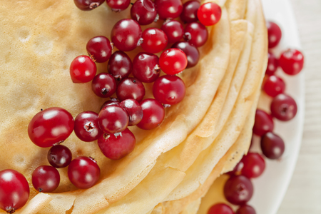 Stack of pancakes with cranberries closeup