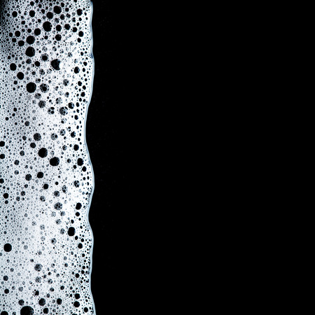 laundry detergent: Foam bubbles abstract dark background