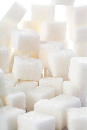 White sweet sugar cubes assortment closeup background