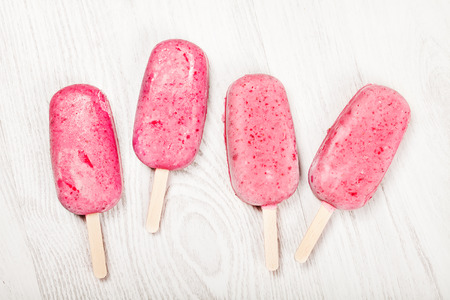 Strawberry popslice icecream on light wooden background Stock Photo