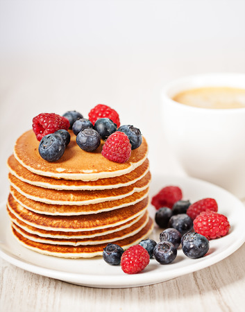 Stack of pancakes with berries breakfast meal Stock Photo