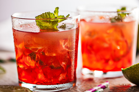 Red cold summer cocktail drink with mint
