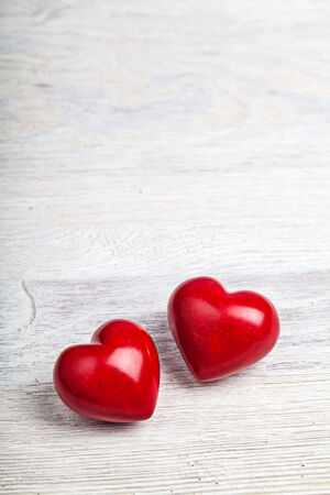 Red hearts on white table valentine background