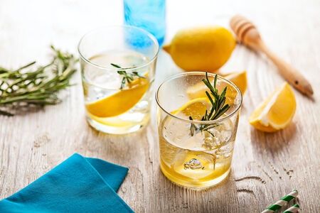 fruit in water: Rosemary lemonade summer cold cocktail drink