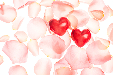 Rose petals and hearts valentine light isolated background