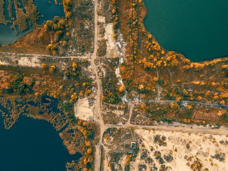 Autumn aerial drone nature landscape with trees and roads