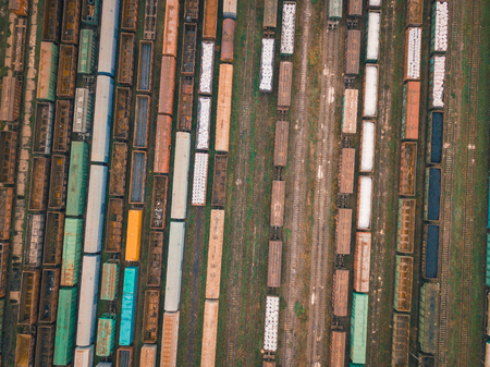 Aerial drone landscape with cargo trains on railroad station