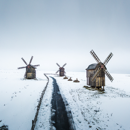 Winter aerial drone landscape with snow old wooden rustic windmills Stock Photo
