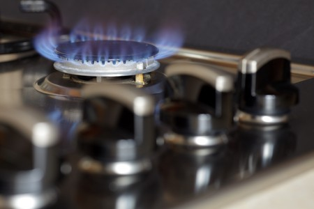 gas cooker: Flames of gas stove black background Stock Photo