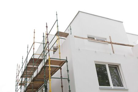 scaffolding on building house wall, on construction site isolated