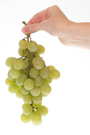 White grape cluster in hand, isolated on white  Stock Photo