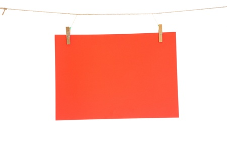 red blank paper sheet on a clothes line. Isolated on white background.