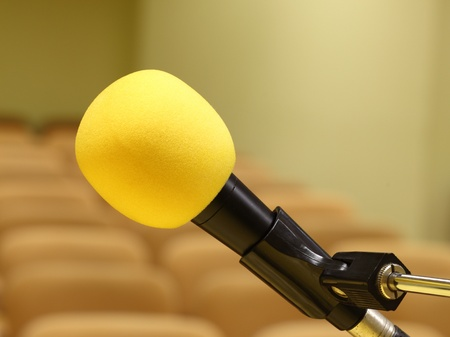 Microphone at conference - rows of empty seats texture