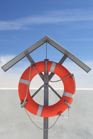 A detailed shot of a life buoy - blue sky photo