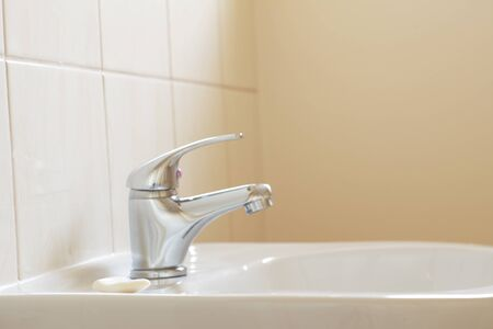 Bathroom interior with white sink and faucet - mixer tap  Stock Photo